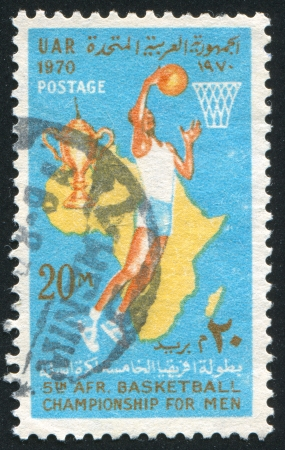 EGYPT - CIRCA 1970: stamp printed by Egypt, shows Basketball player, map of Africa, Cup, Basket, ball, circa 1970
