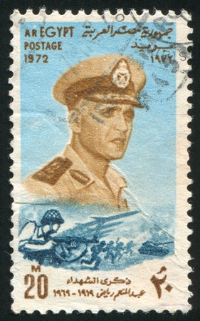 EGYPT - CIRCA 1972: stamp printed by Egypt, shows Abdel Moniem Riad portrait, battle, circa 1972