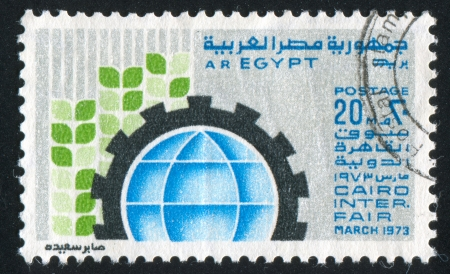 EGYPT - CIRCA 1973: stamp printed by Egypt, shows Cogwheel, globe, leafs, circa 1973