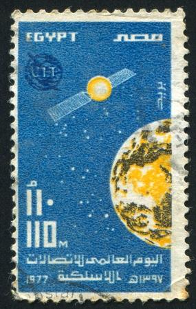 abjad: EGYPT - CIRCA 1977: stamp printed by Egypt, shows Earth, satellite, emblem, circa 1977