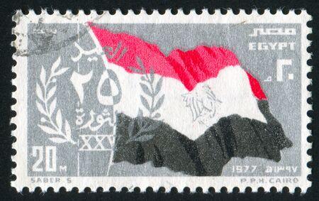 EGYPT - CIRCA 1977: stamp printed by Egypt, shows National flag of Egypt, emblem, circa 1977