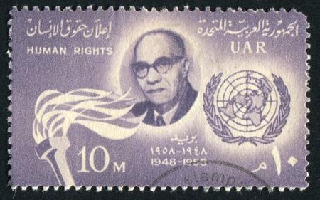 abjad: EGYPT - CIRCA 1958: stamp printed by Egypt, shows Mahmoud Azmy portrait, torch, UN emblem, circa 1958