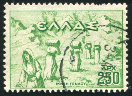 GREECE - CIRCA 1946: stamp printed by Greece, shows Women carrying ammunition in Pindus Mountains, circa 1946 Stock Photo - 14721050
