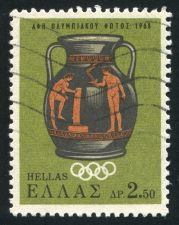 GREECE - CIRCA 1968: stamp printed by Greece, shows Lighting of the Olympic torch for the 19th Olympic games, Mexico city, circa 1968 Stock Photo - 14720616
