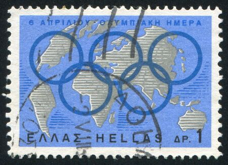 GREECE - CIRCA 1967: stamp printed by Greece, shows World map and Olympic rings, circa 1967 Stock Photo - 14721075