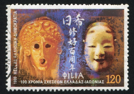diplomatic: GREECE - CIRCA 1999: stamp printed by Greece, shows Greece, Japan diplomatic relations, mask, circa 1999 Editorial