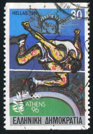 GREECE - CIRCA 1989: stamp printed by Greece, shows High jumper and Ancient Olympia, circa 1989
