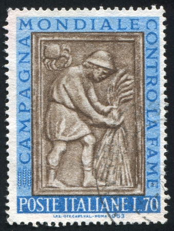 ITALY - CIRCA 1963: stamp printed by Italy, shows Harvester tying sheaf, sculpture from Maggiore Fountain, Perugia, circa 1963 Stock Photo - 14755762