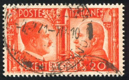 adolf: ITALY - CIRCA 1941: stamp printed by Italy, shows Adolf Hitler and Benito Mussolini, circa 1941