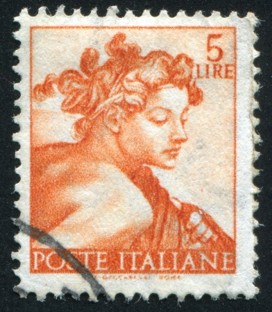 ITALY - CIRCA 1961: stamp printed by Italy, shows Designs from Sistine Chapel by Michelangelo, Head of the slave, circa 1961