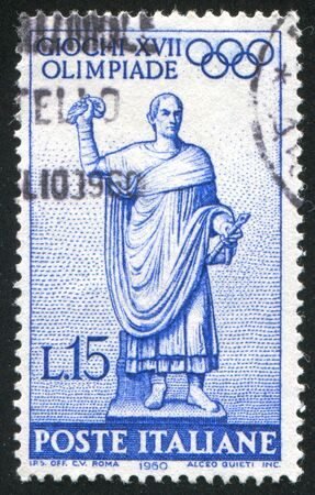 ITALY - CIRCA 1960: stamp printed by Italy, shows Statue of the Roman Consul on way to the Olympic games, circa 1960 Stock Photo - 14755687
