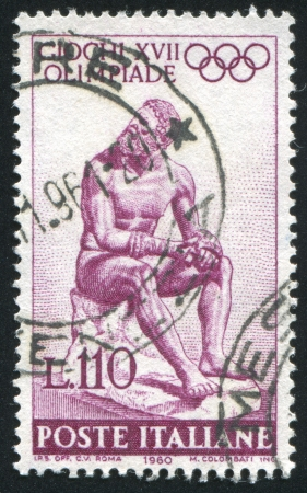 ITALY - CIRCA 1960: stamp printed by Italy, shows Statue of the Seated boxer, circa 1960 Stock Photo - 14755651