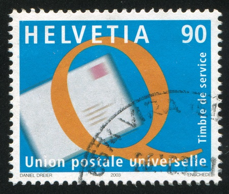 upu: SWITZERLAND - CIRCA 2003: stamp printed by Switzerland, shows Service Quality Improvement, Letter, Q, circa 2003 Editorial