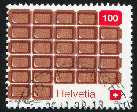 SWITZERLAND - CIRCA 2008: stamp printed by Switzerland, shows Bar of chocolate, circa 2008