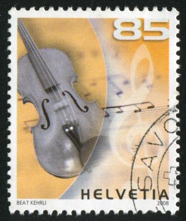 SWITZERLAND - CIRCA 2008: stamp printed by  Switzerland, Musical Instruments, Violin, circa 2008 Stock Photo - 14755774