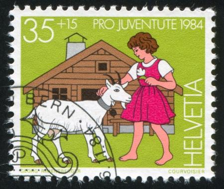 window seal: SWITZERLAND - CIRCA 1984: stamp printed by Switzerland, shows Heidi, Girl,  circa 1984