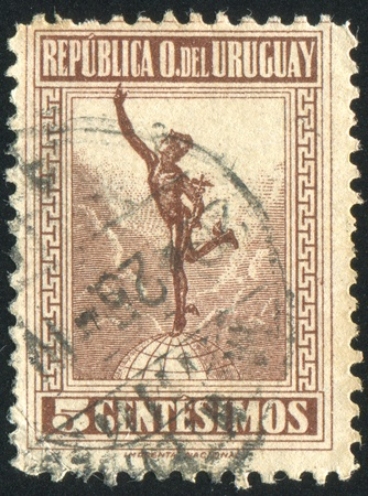 mercury staff: URUGUAY - CIRCA 1922: stamp printed by Uruguay, shows Mercury, circa 1922 Editorial