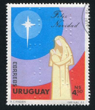 jesus face: URUGUAY - CIRCA 1983: stamp printed by Uruguay, shows Virgin Mary and Christ, circa 1983
