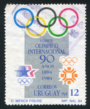 coubertin: URUGUAY - CIRCA 1985: stamp printed by Uruguay, shows Olympic Rings, circa 1985