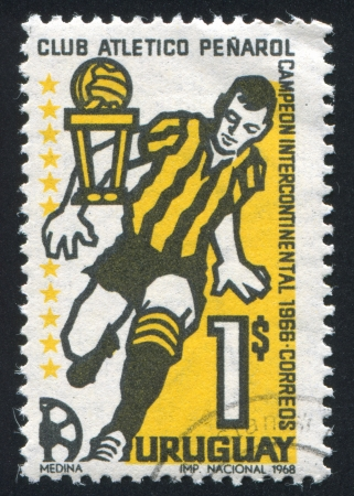 URUGUAY - CIRCA 1968: stamp printed by Uruguay, shows Soccer Player and Trophy, circa 1968