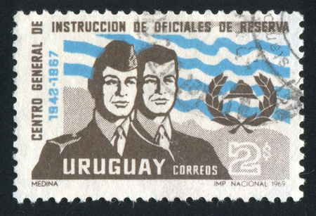 civilian: URUGUAY - CIRCA 1969: stamp printed by Uruguay, shows Training Center Emblem and Officer in Uniform and as Civilian, circa 1969