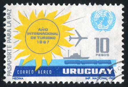 means of transportation: URUGUAY - CIRCA 1968: stamp printed by Uruguay, shows Sun, UN Emblem and Transportation Means, circa 1968