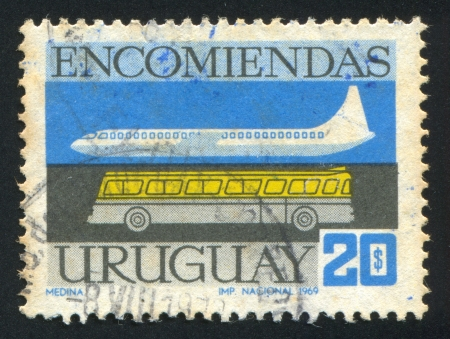 URUGUAY - CIRCA 1969: stamp printed by Uruguay, shows Plane and Bus, circa 1969
