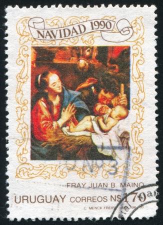 URUGUAY - CIRCA 1990: stamp printed by Uruguay, shows The Nativity by Brother Juan Maino, circa 1990