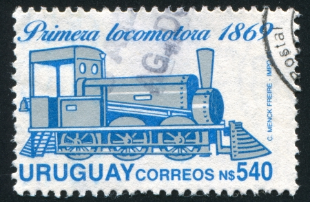 URUGUAY - CIRCA 1969: stamp printed by Uruguay, shows Old Steam Locomotive, circa 1969 Stock Photo - 14756501