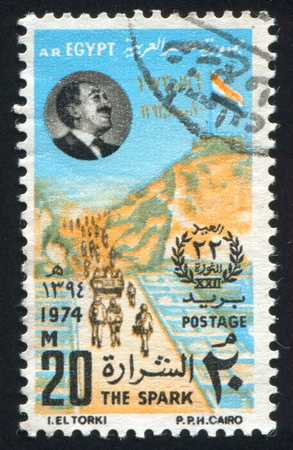 EGYPT - CIRCA 1974: stamp printed by Egypt, shows Fortress, troops on the bridge, Anwar Sadat portrait, circa 1974