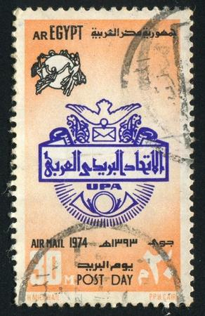 abjad: EGYPT - CIRCA 1974: stamp printed by Egypt, shows Globe, nymphs, emblem, circa 1974 Editorial