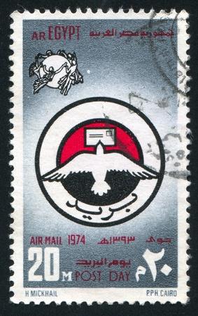 EGYPT - CIRCA 1974: stamp printed by Egypt, shows Globe, nymphs, emblem, circa 1974