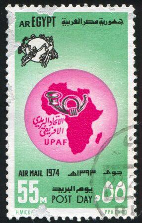 abjad: EGYPT - CIRCA 1974: stamp printed by Egypt, shows Globe, nymphs, emblem, map of Africa, circa 1974