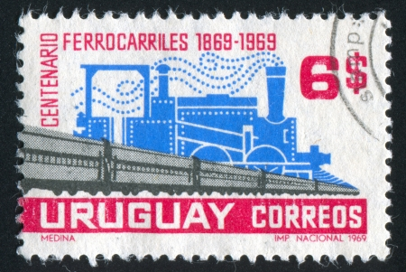 URUGUAY - CIRCA 1969: stamp printed by Uruguay, shows Old Steam Locomotive and Modern Railroad Cars, circa 1969