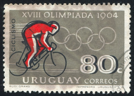 URUGUAY - CIRCA 1965: stamp printed by Uruguay, shows Cyclist, Tokyo Olympic Games, circa 1965 Stock Photo - 14817638
