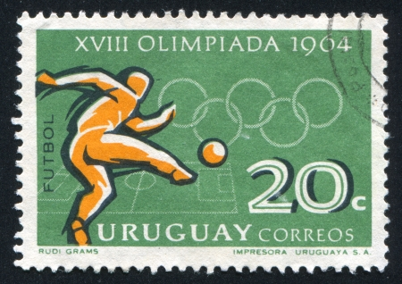URUGUAY - CIRCA 1965: stamp printed by Uruguay, shows Soccer Player, Tokyo Olympic Games, circa 1965