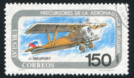 fixed wing aircraft: FINLAND - CIRCA 1974: stamp printed by Finland, shows Nieuport biplane, circa 1974
