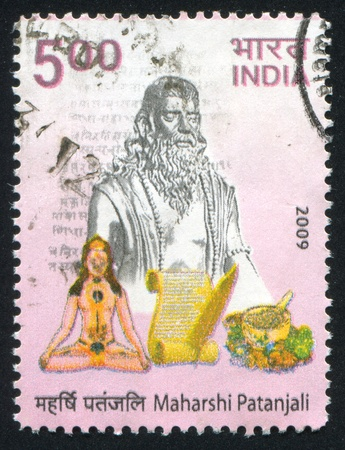 sutras: INDIA - CIRCA 2009: stamp printed by India, shows Maharshi Patanjali statue, scroll, circa 2009