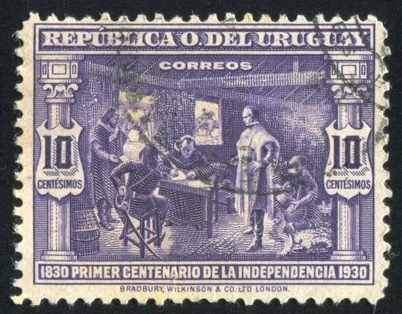 dictating: URUGUAY - CIRCA 1930: sello impreso por Uruguay, muestra Artigas dictando instrucciones para el Congreso 1813, alrededor de 1930 Editorial