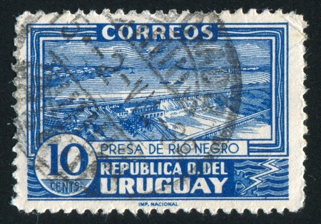 URUGUAY - CIRCA 1937: stamp printed by Uruguay, shows Power Dam on Black River, circa 1937