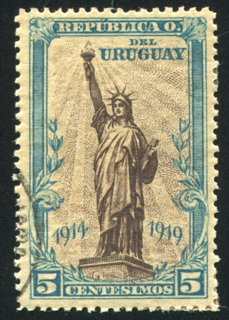 URUGUAY - CIRCA 1919: stamp printed by Uruguay, shows Statue of Liberty, New York Harbor, circa 1919 Stock Photo - 15102365
