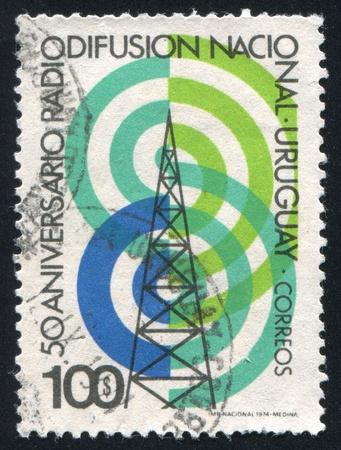 telegraphy: URUGUAY - CIRCA 1974: stamp printed by Uruguay, shows Radio Tower and Waves, circa 1974