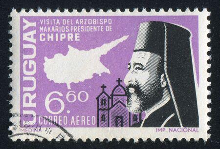 archbishop: URUGUAY - CIRCA 1967: stamp printed by Uruguay, shows Archbishop Makarios and Map of Cyprus, circa 1967 Editorial