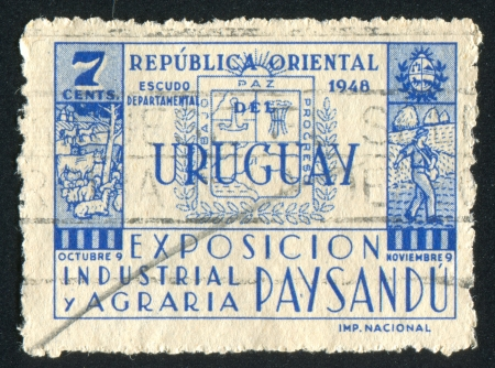 URUGUAY - CIRCA 1948: stamp printed by Uruguay, shows Coat of Arms of Paysandu, circa 1948 Stock Photo - 15102391