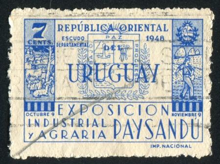 URUGUAY - CIRCA 1948: stamp printed by Uruguay, shows Coat of Arms of Paysandu, circa 1948 Stock Photo - 15102391