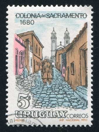 URUGUAY - CIRCA 1970: stamp printed by Uruguay, shows Cobbled Street in Colonia del Sacramento, circa 1970
