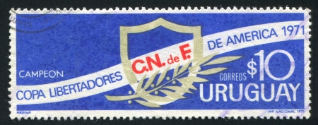 URUGUAY - CIRCA 1971: stamp printed by Uruguay, shows Emblem and Laurel, circa 1971