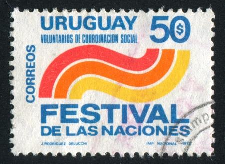 coordinacion: URUGUAY - CIRCA 1973: sello impreso por Uruguay, muestra Emblema de Voluntarios de Coordinaci�n Social, alrededor del a�o 1973 Editorial