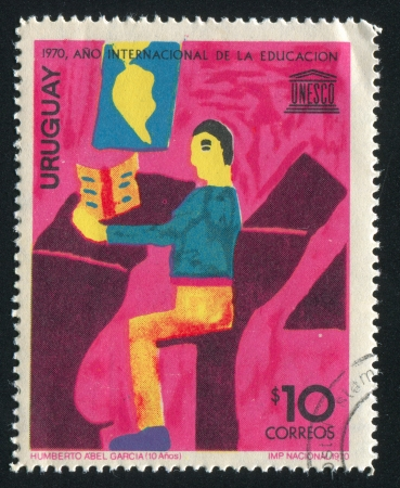 URUGUAY - CIRCA 1970: stamp printed by Uruguay, shows Children's Drawing, Boy Sitting at School Desk, circa 1970