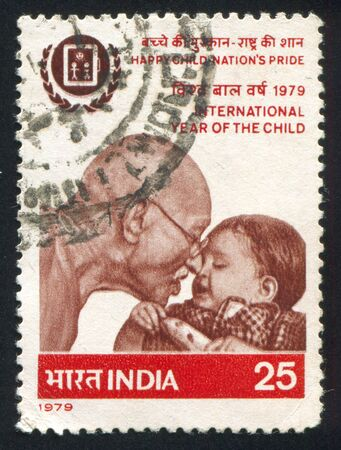 mahatma: INDIA - CIRCA 1979: stamp printed by India, shows Mahatma Gandhi and child, circa 1979